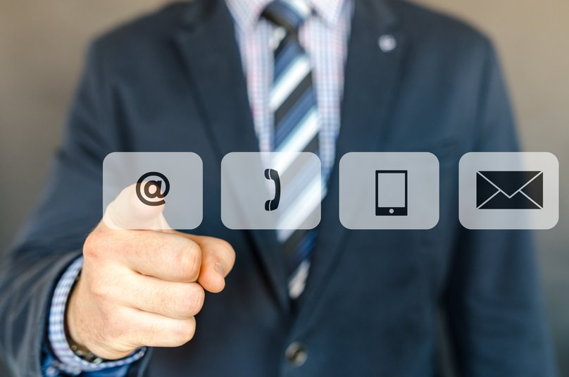Businessman Pointing Messaging Icons.jpg