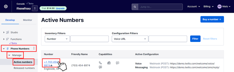 Twilio Console listing active phone number in the Twilio Account. Pointer is clicking on the active phone link.