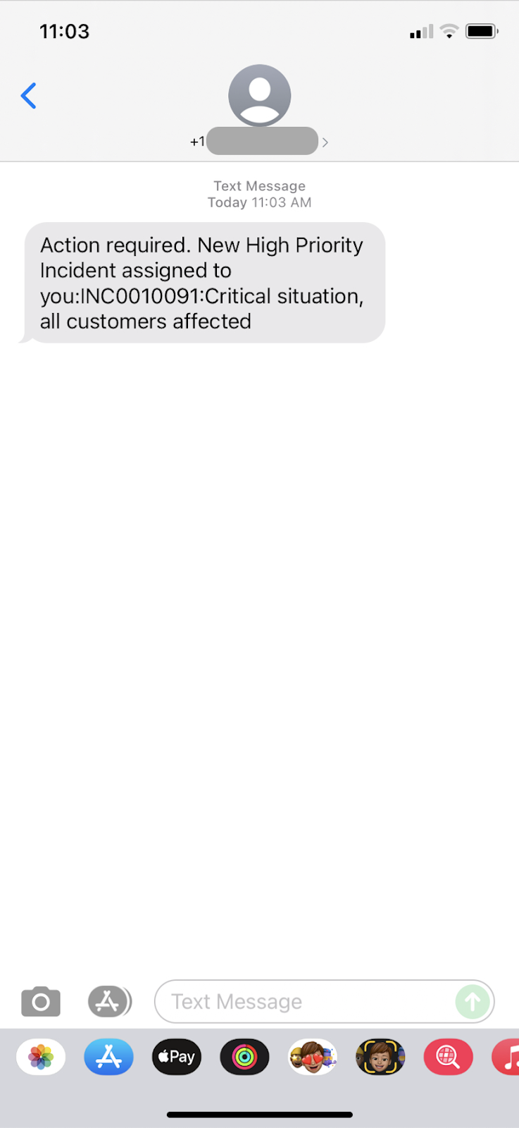 A screenshot of the SMS message sent by ServiceNow Notify