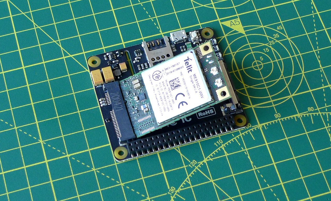 Slot the modem card into the Base Hat
