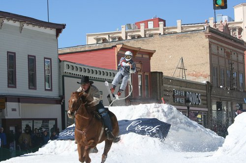 A person on skis being pulled by a horse in a 2009 Skijoring event in Leadville, Colorado. Photo by Kaila Angello
