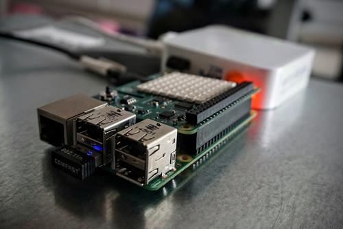 Raspberry Pi 2 Model B with Sense HAT Sensor board and LED matrix add-on board and WiFi dongle