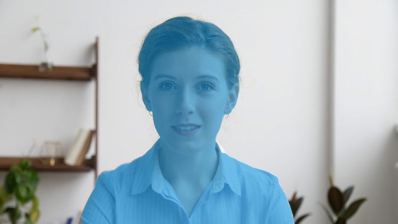 The part of the image that contains the person's body is highlighted in blue, while the room in the background is unchanged.